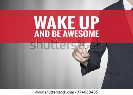 Wake Up and Be Awesome word on virtual screen push by business woman red tab - stock photo