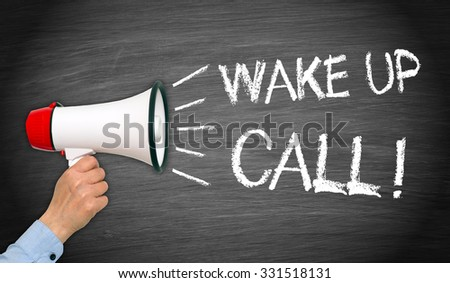 Wake up Call - female hand with megaphone and text - stock photo