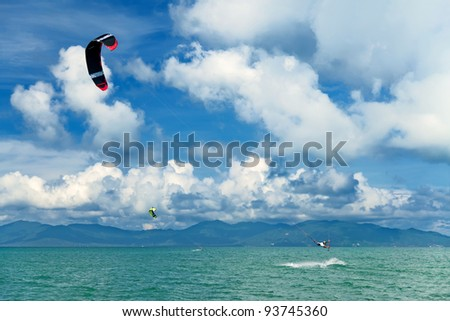 Wakeboarder jumping from water in open sea. Koh Samui, Thailand - stock photo