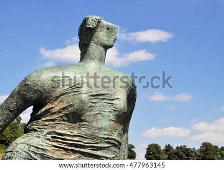 WAKEFIELD, UK - AUGUST 6, 2016. Draped Seated Woman, a 1957-58 bronze sculpture by Henry Moore, exhibiting at the Yorkshire Sculpture Park, near Wakefield, west Yorkshire, UK.