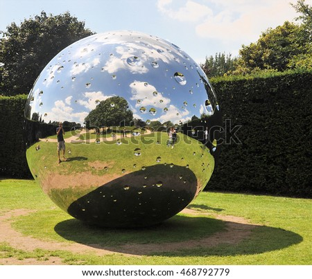 "WAKEFIELD, UK - AUGUST 6, 2016. Moon is a 10' 6"" (3.2 m) diameter stainless steel sculpture by Swiss artist Not Vital, exhibiting at Yorkshire Sculpture Park, near Wakefield, west Yorkshire, UK."