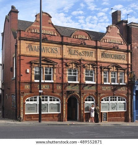 WAKEFIELD, UK - AUGUST 6, 2016. The fine polished terracotta tiled facade of The Elephant & Castle pub dates from the 19th century at 109 Westgate, in Wakefield, Yorkshire, UK.