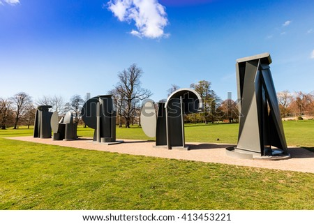 WAKEFIELD, YORKSHIRE, UK - APRIL 19, 2016: Promenade, the sculpture created by Sir Anthony Caro in 1966 for the Tuileries Gardens in Paris and exhibited permanently at the Yorkshire Sculpture Park. - stock photo