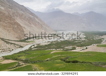 Wakhan coridor. Divided by Panj river (Amu Darya) next to Pamir highway on Marco Polo silk road. Gorno Badakhsan province, Tajikistan, Central Asia