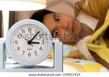 Waking Asian Man - stock photo