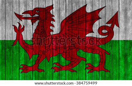 Wales Flag on old wood texture background - stock photo