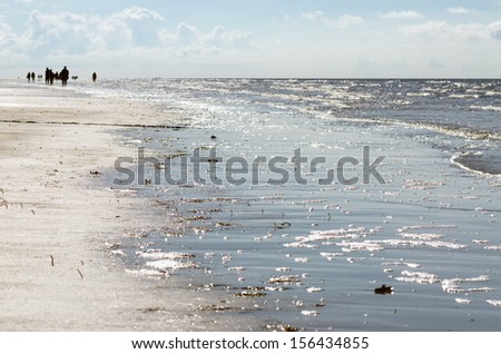 walk at the beach on the North Sea at Sankt Peter-Ording - stock photo