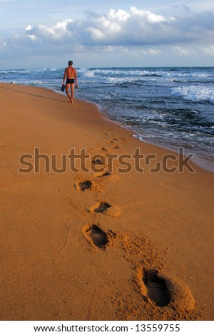 Walk away to the sunset - stock photo