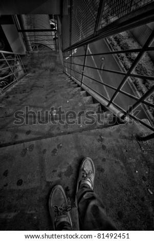 walk down from upstairs. - stock photo