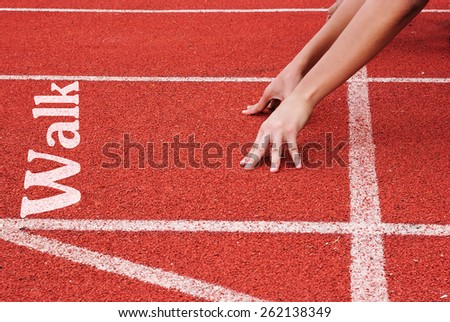 walk - hands on starting line - stock photo