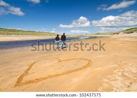 Walk on the beach of loving couple
