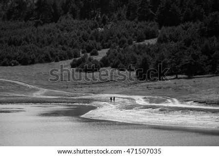 walk on the lake beach, couple in black and white landscape