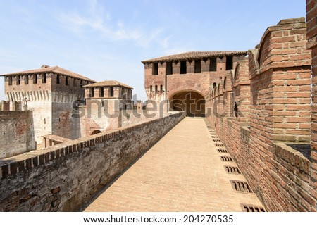 walk on top of the walls, Soncino Castle, view of north side of main inner court in the ancient Sforzesco Castle from the walk set on top of the castle walls, shot in bright summer light  - stock photo