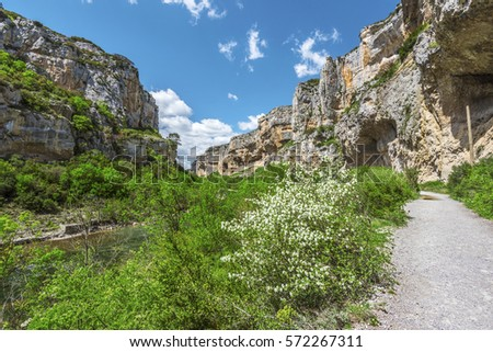 Walk pass along the flow of Irati River in Lumbier Canyon, which makes a part of Sierra de Leyre mountain chain in Pyrenees of Spanish Navarra