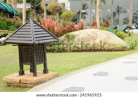 Walk-way in garden with vintage lamp - stock photo