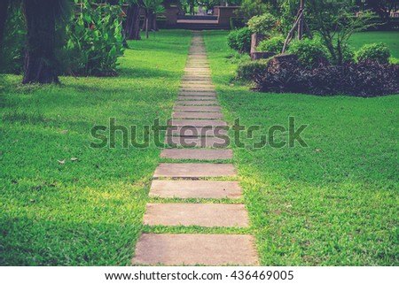 Walk way in the garden (Vintage filter effect used) - stock photo