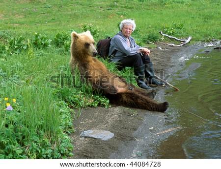 Walk with a bear. - stock photo