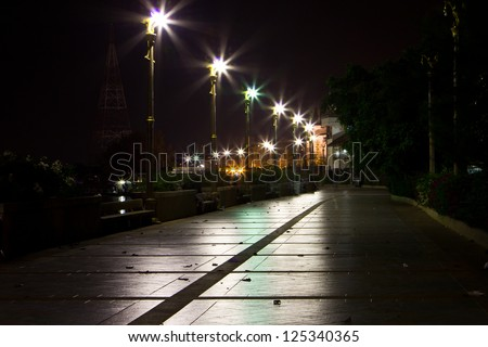 walk with street lamps at night cityscape - stock photo