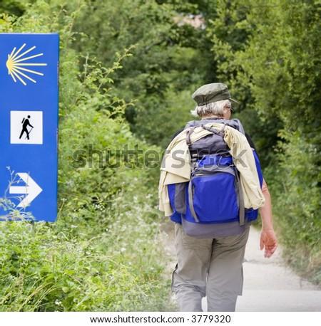 Walker doing the way of Saint James (Camino de Santiago) in Spain. - stock photo
