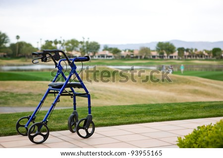 Walker Outdoors on Patio With Golf Course In Background - stock photo
