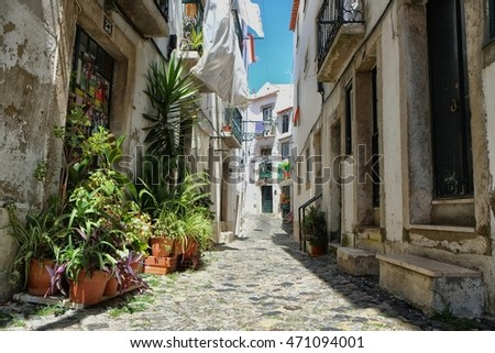 Walking a cozy, narrow street with cobblestone in Alfama