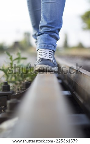 Walking a lonely road - stock photo