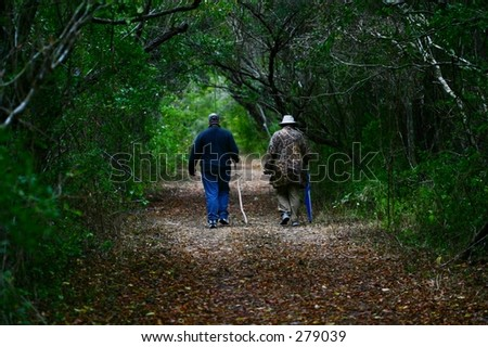 Walking along a trail in the woods. - stock photo