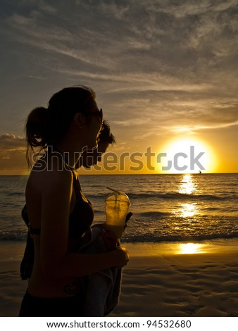 walking along the beach - stock photo