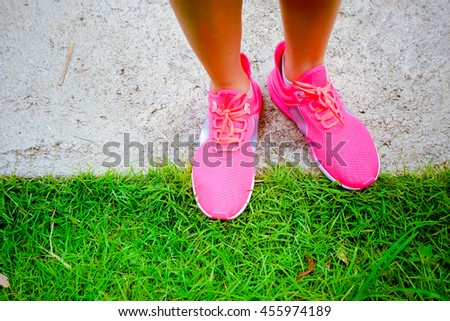 Walking and jogging woman with athletic legs and running shoes.