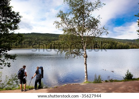 Walking and resting on a camping trip by a lake - stock photo