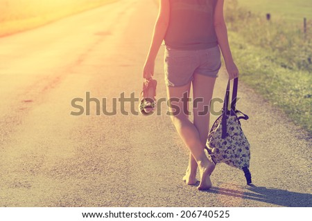 Walking away in summer sunset - stock photo