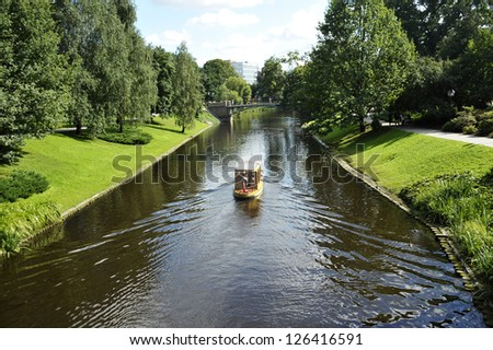 Walking boat on the city channel in Riga (Latvia) - stock photo