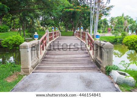 Walking bridge over a stream, at the park. - stock photo