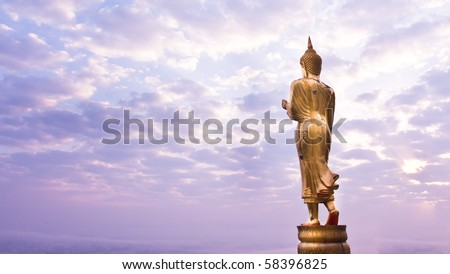 Walking Buddha statue at northern of thailand - stock photo
