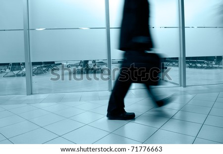 Walking business people silhouette. Blue tint. - stock photo