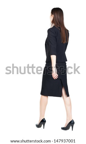 walking business woman. back view. going young girl in  suit. Rear view people collection.  back side view of person.  Isolated over white background.