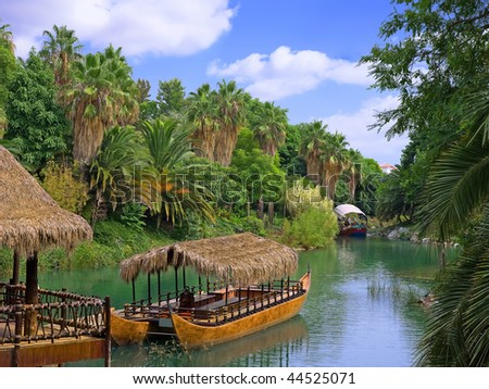 Walking canoe on river in French Polynesia. - stock photo