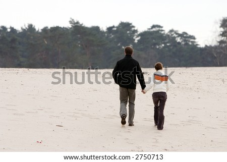 Walking couple at Soester duinen (Soest, the Netherlands)