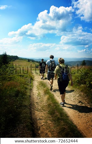 Walking Family / Hikers in mountain - stock photo