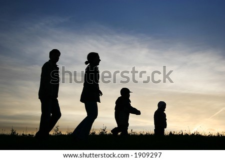 walking family of four on sky - stock photo