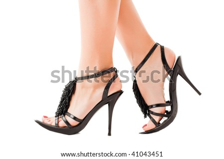 Walking feet of a woman. Elegant shoes. Isolated over white