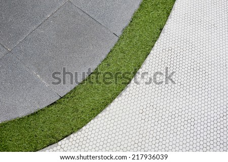 Walking foot path with green grass and tiles background texture - stock photo