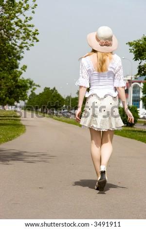Walking girl. Back side view. - stock photo