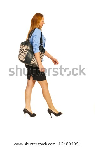 Walking happy executive woman to work isolated on white background - stock photo