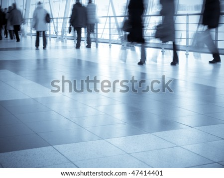 Walking in a hallway of a shopping center - stock photo