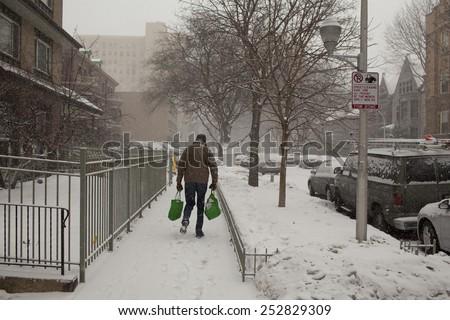 walking in snow  - stock photo