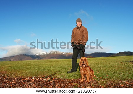 Walking in The breath taking Lake District at Derwentwater Lakeside near Keswick, England  during December with snow capped mountains in background - stock photo