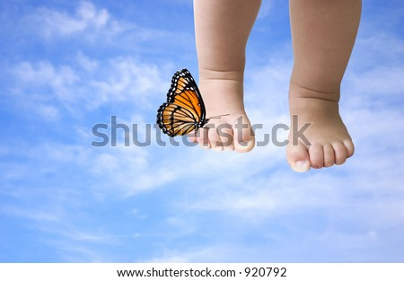 walking in the clouds ( baby feet with butterfly on a blue sky background, photoshop work) - stock photo