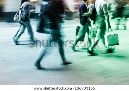 Walking in the commercial street, crowds blurred motion background - stock photo