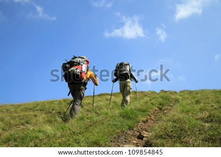 Walking in the mountains. - stock photo